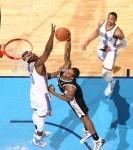 Kawhi Leonard #2 of the San Antonio Spurs dunks over Serge Ibaka #9