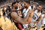 LeBron James #6 of the Miami Heat and Tim Duncan #21 of the San Antonio Spurs