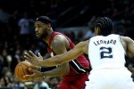 LeBron James #6 of the Miami Heat looks to pass while Kawhi Leonard #2 o