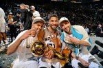 Manu Ginobili #20, Tony Parker #9, and Tim Duncan #21 of the San Antonio Spurs