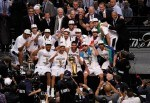 The San Antonio Spurs celebrate with the Larry O'Brien trophy