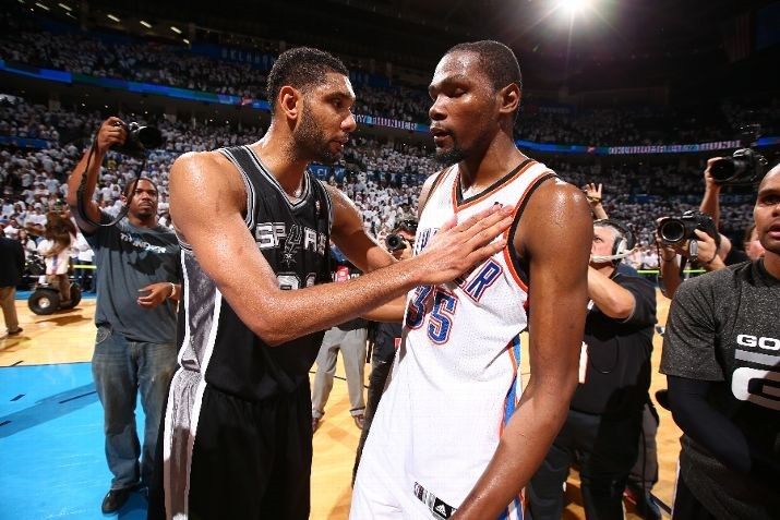 Tim Duncan #21 of the San Antonio Spurs and Kevin Durant #35