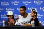 Tim Duncan #21 of the San Antonio Spurs speaks to the media with his children Sydney and Draven