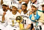 Tony Parker #9 and Tim Duncan #21, and Manu Ginobili #20 of the San Antonio Spurs