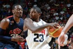 Kyrie Irving #23 of the USA White Team drives to the basket against John Wall #30 of the USA Blue Team