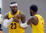 Cleveland Cavaliers' LeBron James (23) jokes with Kyrie Irving