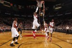 Alec Burks #10 of the Utah Jazz shoots against the Portland Trail Blazers