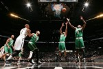 Avery Bradley #0 and Jeff Green #8 of the Boston Celtics