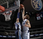 Dirk Nowitzki #41 of the Dallas Mavericks gets his shot blocked by Vince Carter #15 of the Memphis Grizzlies