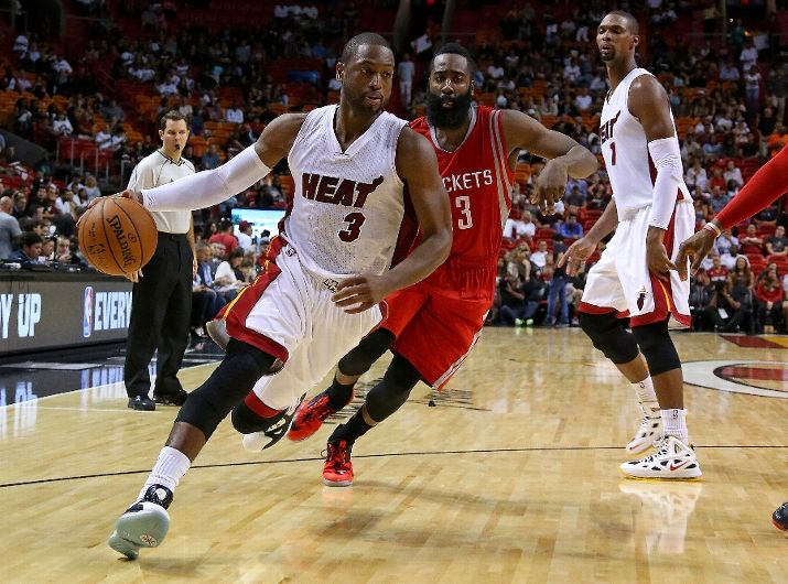 Dwyane Wade #3 of the Miami Heat drives on James Harden #13