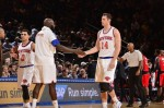 Jason Smith #14 of the New York Knicks shakes hands with Quincy Acy #4