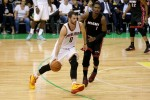 Kevin Love #0 of the Cleveland Cavaliers handles the basketball against Chris Bosh #1 of the Miami Heat