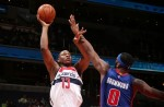 Kevin Seraphin #13 of the Washington Wizards shoots against Andre Drummond