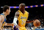 Kobe Bryant #24 of the Los Angeles Lakers handles the ball against Klay Thompson #11