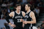 Mirza Teletovic #33 talk s with Bojan Bogdanovic #44 of Brooklyn Nets