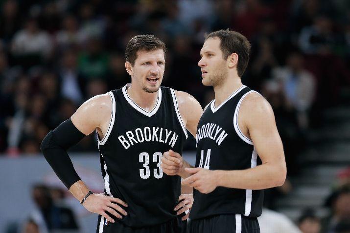 Mirza Teletovic #33 talk s with Bojan Bogdanovic #44 of Brooklyn Nets