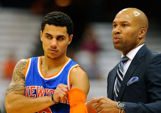 Shane Larkin #0 takes with head coach Derek Fisher