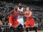 Solomon Jones #25 of the Chicago Bulls, Doug McDermott #3 of the Chicago Bulls and Andre Drummond #0