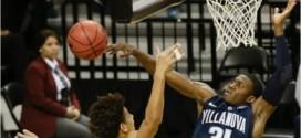 L'énorme contre du jour:Dylan Ennis (1m88) contre le dunk de DJ Wilson (2m06)