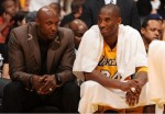 Lamar Odom and Kobe Bryant converse on the bench