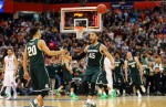 Denzel Valentine #45 of the Michigan State Spartans celebrates with teammate Travis Trice #20 a