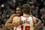 E'Twaun Moore #55 of the Chicago Bulls gets a hug from teammate Pau Gasol #16