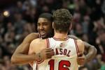 E'Twaun Moore #55 of the Chicago Bulls gets a hug from teammate Pau Gasol #16