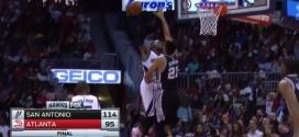 Tim Duncan contre la tentative de dunk de Paul Millsap
