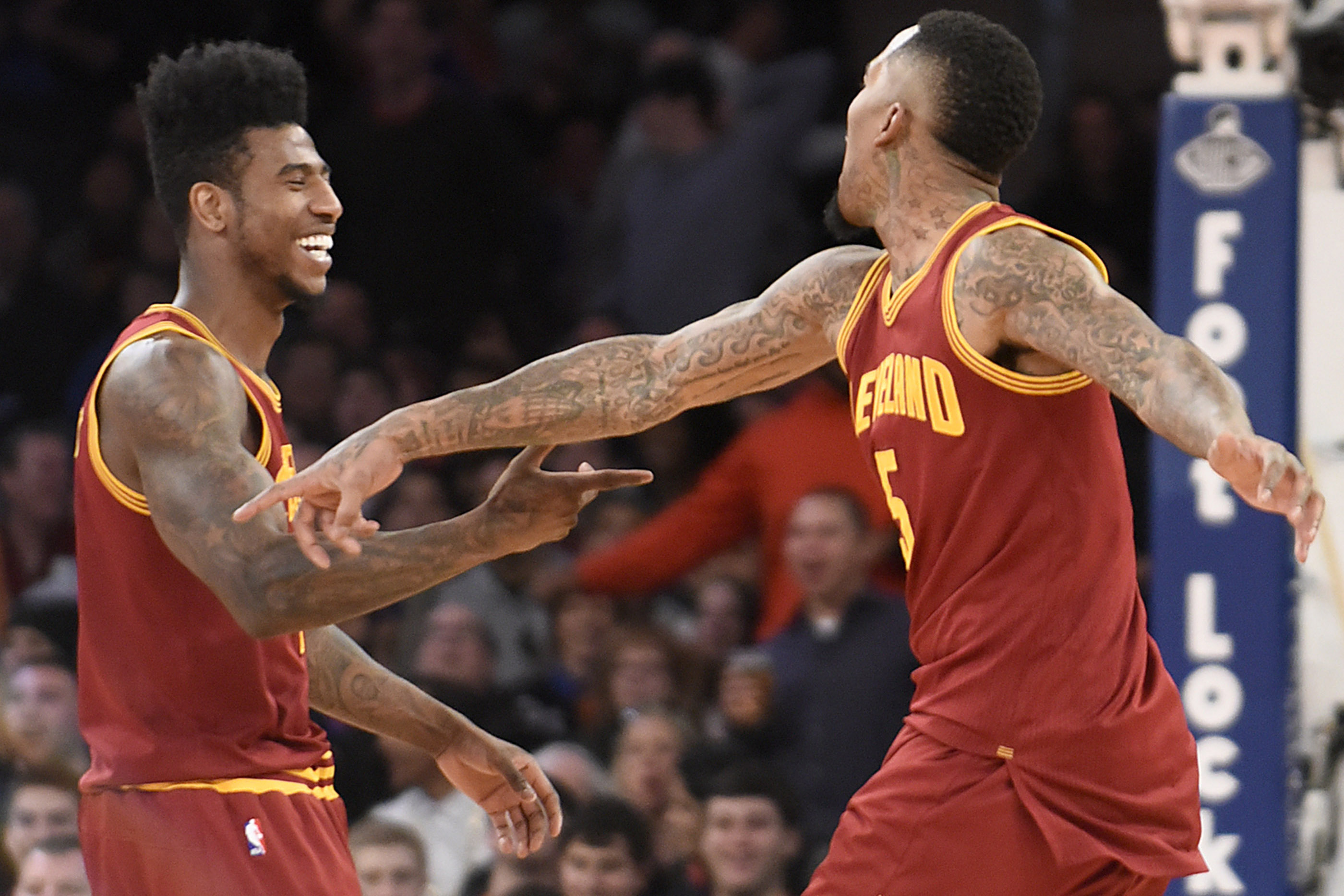 02/22/14 -Cleveland Cavaliers vs. New York Knicks. Cavs J.R. Smith is greeted by Iman Shumpert after making a reverse dunk during the fourth quarter. The Cavs defeated the Knicks 101-81. Photo by Bill Kostroun
