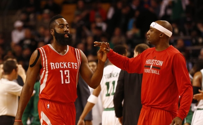 Jan 30, 2015; Boston, MA, USA; Houston Rockets guard James Harden (13) and guard Jason Terry (31) celebrate against the Boston Celtics during the first half at TD Garden. Mandatory Credit: Mark L. Baer-USA TODAY Sports