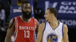 Golden State Warriors guard Stephen Curry (30) smiles next to Houston Rockets guard James Harden (13) during the first half of an NBA basketball game in Oakland, Calif., Wednesday, Jan. 21, 2015. (AP Photo/Jeff Chiu)