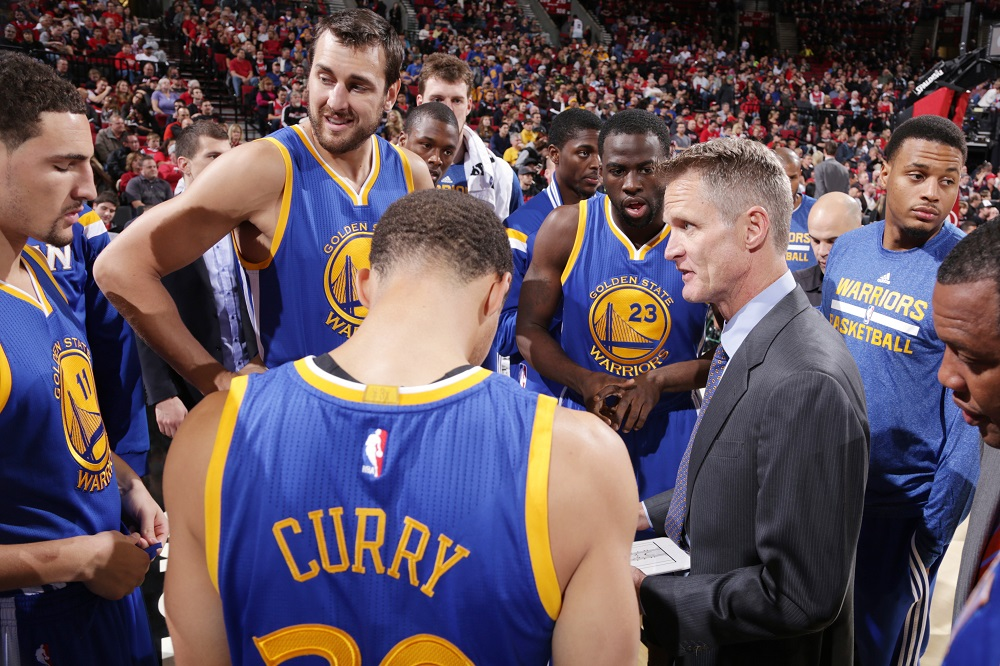 PORTLAND, OR - NOVEMBER 2:  Steve Kerr of the Golden State Warriors talks with his team during the game against the Portland Trail Blazers on November 2, 2014 at the Moda Center Arena in Portland, Oregon. NOTE TO USER: User expressly acknowledges and agrees that, by downloading and or using this photograph, user is consenting to the terms and conditions of the Getty Images License Agreement. Mandatory Copyright Notice: Copyright 2014 NBAE (Photo by Sam Forencich/NBAE via Getty Images)