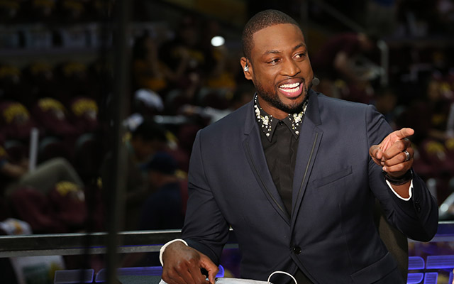 CLEVELAND, OH - JUNE 16:  Dwyane Wade of the Miami Heat appears on ESPN before Game Six of the 2015 NBA Finals between the Cleveland Cavaliers and the Golden State Warriors on June 16, 2015 at Quicken Loans Arena in Cleveland. Ohio.  NOTE TO USER: User expressly acknowledges and agrees that, by downloading and or using this Photograph, user is consenting to the terms and conditions of the Getty Images License Agreement. Mandatory Copyright Notice: Copyright 2015 NBAE (Photo by Gary Dineen/NBAE via Getty Images)