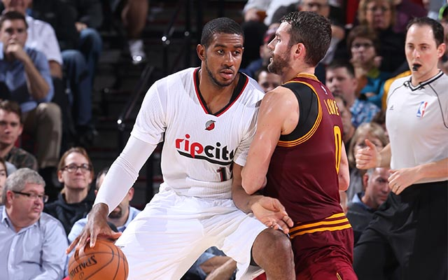 PORTLAND, OR - NOVEMBER 4:  LaMarcus Aldridge #12 of the Portland Trail Blazers handles the ball against Kevin Love #0 of the Cleveland Cavaliers on November 4, 2014 at the Moda Center Arena in Portland, Oregon. NOTE TO USER: User expressly acknowledges and agrees that, by downloading and or using this photograph, user is consenting to the terms and conditions of the Getty Images License Agreement. Mandatory Copyright Notice: Copyright 2014 NBAE (Photo by Sam Forencich/NBAE via Getty Images)