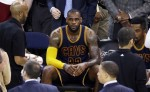 Cleveland Cavaliers forward LeBron James sits on the bench during the second half of Game 5 of basketball's NBA Finals against the Golden State Warriors in Oakland, Calif., Sunday, June 14, 2015. (AP Photo/Eric Risberg)
