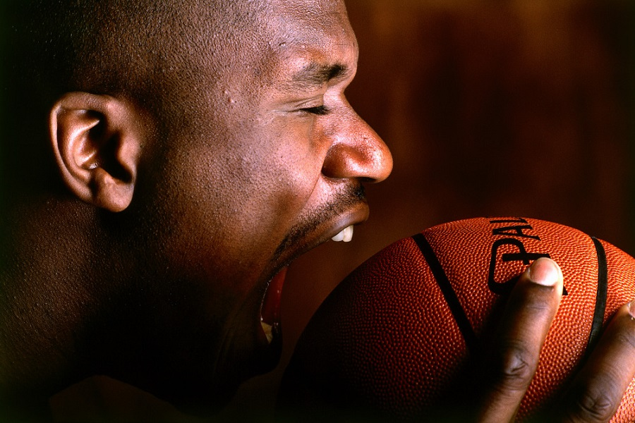 ORLANDO, FL - 1995:  Shaquille O'Neal #32 of the Orlando Magic tries to bite a basketball during a portrait session circa 1995 in Orlando, Florida.   NOTE TO USER: User expressly acknowledges and agrees that, by downloading and/or using this Photograph, user is consenting to the terms and conditions of the Getty Images License Agreement.  Mandatory Copyright Notice: Copyright 1995 NBAE (Photo by Garrett Ellwood/NBAE via Getty Images)