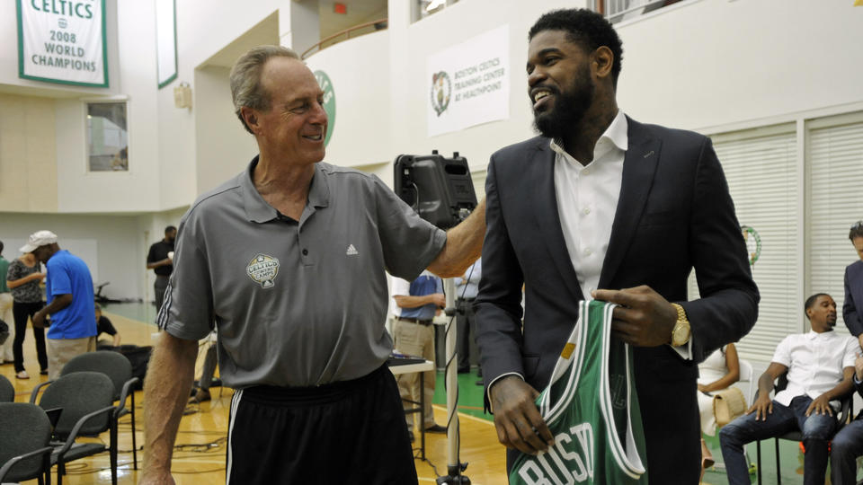 (Waltham, MA, 07/27/15) Celtics great and Basketball Hall of Famer Dave Cowens, left, talks with Amir Johnson after Johnson was introduced as a new member of the Boston Celtics at the Boston Celtics Training Center at Healthpoint in Waltham on Monday, July 27, 2015. Staff photo by Christopher Evans