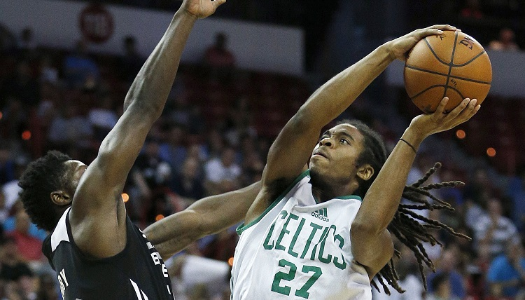 Boston Celtics� Marcus Thornton goes up for a basket against San Antonio Spurs� Will Cherry during the first half of an NBA summer league basketball game Saturday, July 18, 2015, in Las Vegas. (AP Photo/John Locher)