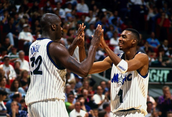 ORLANDO, FL - 1995: Anfernee Hardaway #1 and Shaquille O'Neal #32 of the Orlando Magic high five each other circa 1995 at the Orlando Arena in Orlando, Florida. NOTE TO USER: User expressly acknowledges and agrees that, by downloading and or using this photograph, User is consenting to the terms and conditions of the Getty Images License Agreement. Mandatory Copyright Notice: Copyright 1995 NBAE (Photo by Fernando Medina/NBAE via Getty Images)