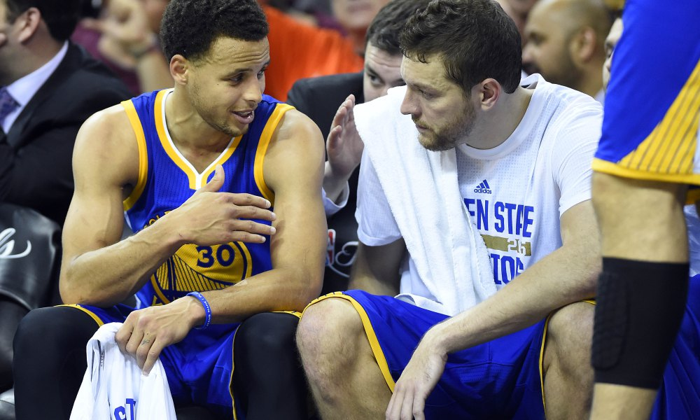 Jun 11, 2015; Cleveland, OH, USA; Golden State Warriors guard Stephen Curry (30) talks to forward David Lee (10) on the bench during the fourth quarter against the Cleveland Cavaliers in game four of the NBA Finals at Quicken Loans Arena. Mandatory Credit: Bob Donnan-USA TODAY Sports ORG XMIT: USATSI-225718 ORIG FILE ID:  20150611_pjc_sd3_144.JPG