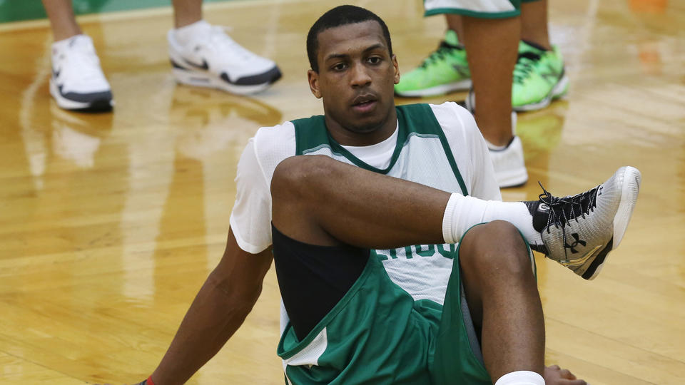 (Waltham, MA - 7/1/15) Jonathan Holmes stretches during practice for the Boston Celtics Summer League, Wednesday, July 01, 2015. Staff photo by Angela Rowlings.