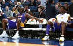 14 Mar 2002:  Shaquille O''Neal #34 and Kobe Bryant #8 of the Los Angeles Lakers sit on the bench during the game against the Golden State Warriors at the Arena in Oakland in Oakland, California.  The Lakers won 110-102.  Mandatory Credit: Rocky Widner/NBAE/Getty Images Digital Image NOTE TO USER: User expressly acknowledges and agrees that, by downloading and/or using this Photograph, User is consenting to the terms and conditions of the Getty Images license Agreement.  Mandatory copyright notice: Copyright 2002 NBAE