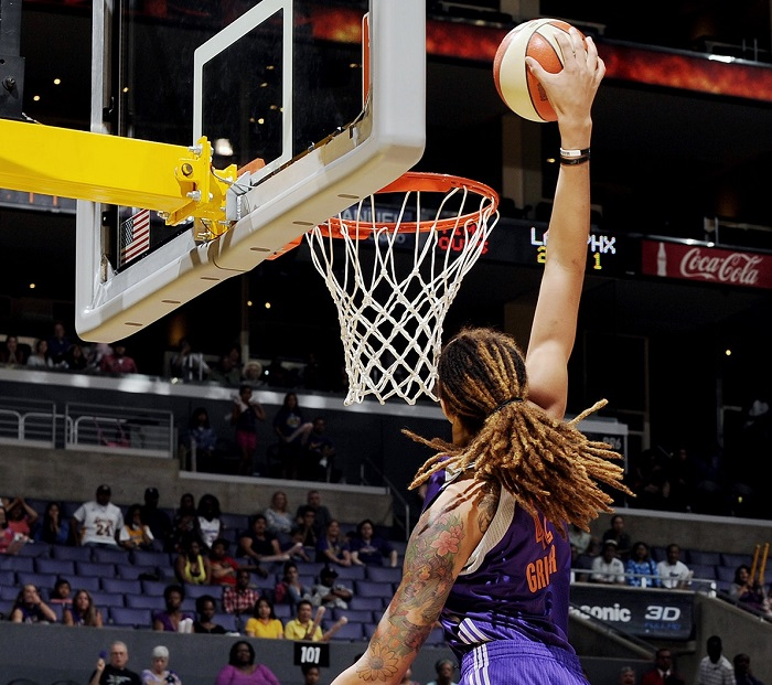 LOS ANGELES, CA - JULY 6:  Brittney Griner #42 of the Phoenix Mercury dunks against Nneka Ogwumike #30 of the Los Angeles Sparks at Staples Center on July 6, 2014 in Los Angeles, California.  NOTE TO USER: User expressly acknowledges and agrees that, by downloading and or using this photograph, User is consenting to the terms and conditions of the Getty Images License Agreement. Mandatory Copyright Notice: Copyright 2014 NBAE  (Photo by Juan Ocampo/NBAE via Getty Images)