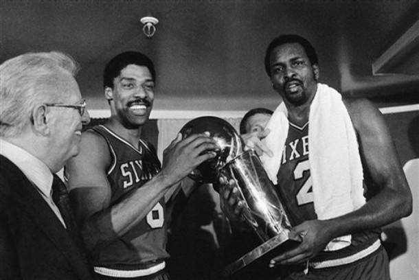 **FILE** In this Tuesday, May 31, 1983 file photo, Philadelphia 76ers Julius Erving, left, and Moses Malone, right, hold the NBA Championship trophy after defeating the Los Angeles Lakers, in  Los Angeles. Twenty five years and nearly 100 seasons have passed since fans last crowded Philadelphia's sidewalks to celebrate a professional sports championship.  (AP Photo/File)