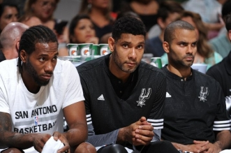 Kawhi Leonard #2 of the San Antonio Spurs, Tim Duncan #21 of the San Antonio Spurs and Tony Parker #9 of the San Antonio Spurs