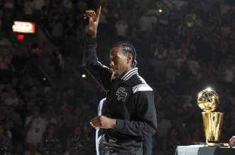 Spurs' Kawhi Leonard (02) acknowledges the crowd after receiving his 2014 NBA Championship ring during the ring ceremony and season opener against the Dallas Mavericks at the AT&T Center on Tuesday, Oct. 28, 2014. (Kin Man Hui/San Antonio Express-News)