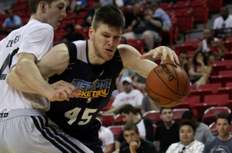 Jul 18, 2013; Las Vegas, NV, USA; Memphis Grizzlies center Jack Cooley dribbles around defending Charlotte Bobcats center Cody Zeller during an NBA Summer League game at the Thomas and Mack Center. Mandatory Credit: Stephen R. Sylvanie-USA TODAY Sports