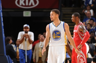 OAKLAND, CA - OCTOBER 15:  Stephen Curry #30 of the Golden State Warriors looks on during the game against the Houston Rockets on October 15, 2015 at Oracle Arena in Oakland, California. NOTE TO USER: User expressly acknowledges and agrees that, by downloading and or using this photograph, user is consenting to the terms and conditions of Getty Images License Agreement. Mandatory Copyright Notice: Copyright 2015 NBAE (Photo by Noah Graham/NBAE via Getty Images)