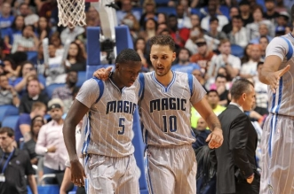 Victor Oladipo #5 of the Orlando Magic and Evan Fournier #10