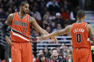 Portland Trail Blazers forward LaMarcus Aldridge, left, celebrates with guard Damian Lillard after scoring a basket during the second half of an NBA basketball game against the Chicago Bulls in Chicago on Thursday, March 21, 2013. The Trail Blazers won 99-89. (AP Photo/Nam Y. Huh)